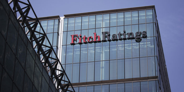 The headquarters of Fitch Ratings Ltd. stands in the Canary Wharf business and shopping district in London, U.K., on Friday, July 12, 2013. Recent data suggest Britain's economic recovery is gaining momentum after a return to growth in the first quarter. Photographer: Simon Dawson/Bloomberg via Getty Images